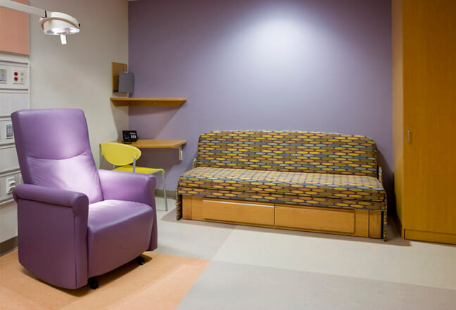 Colorful newly designed hospital room with bed that folds to couch