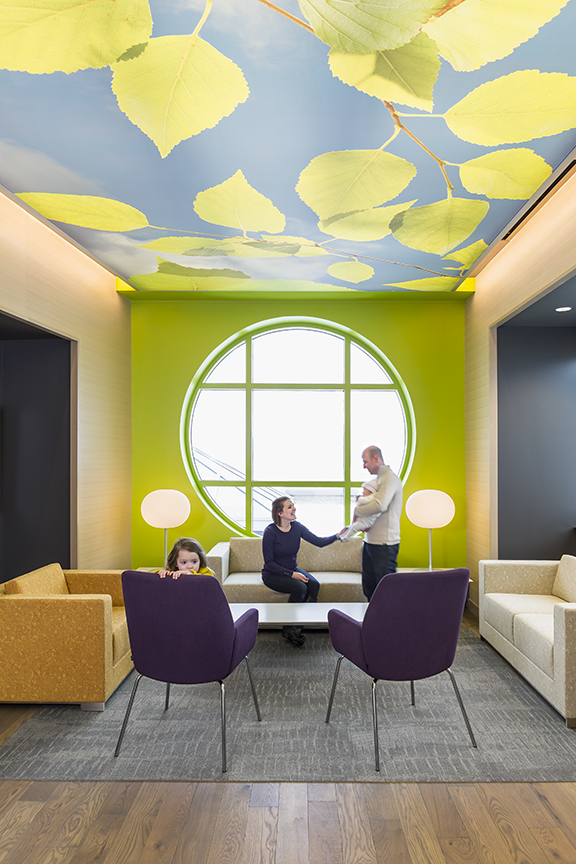 Family hanging out in colorful sitting area in children's pain clinic